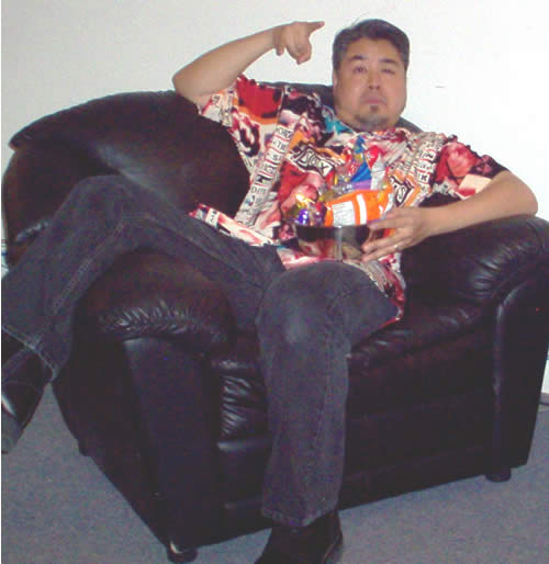 Joey with snacks in a comfy chair in MTV Canada's green room.
