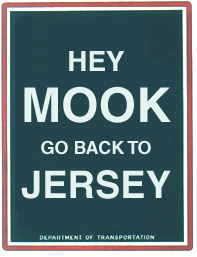 Remixed NYC parking sign that reads: 'Hey MOOK -- go back to JERSEY.'