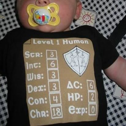 Baby shirt with the baby's stats listed as a Dungeons and Dragons character.