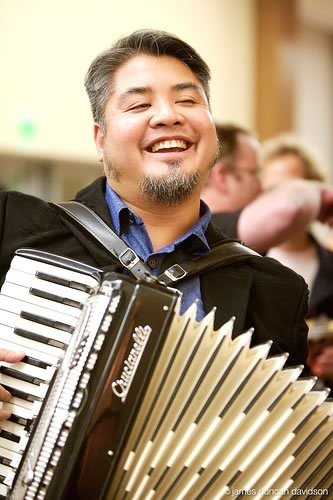 Joey deVilla plays accordion at The Ajax Experience, October 2006. Photo by James Duncan Davidson.