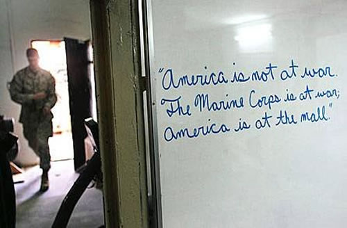 Photo of Marine barracks whiteboard that says: 'America is not at war. The marines are at war. America is at the mall.'