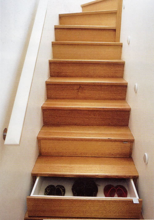 Staircase with drawers embedded in the steps