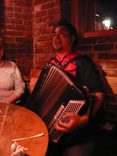 Joey deVilla playing accordion at Grendel's Den, Harvard Square.