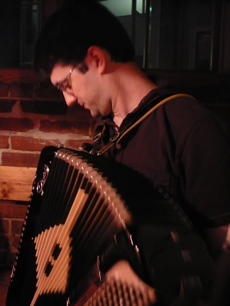 Mike Zole playing accordion at Grendel's Den, Harvard Square.