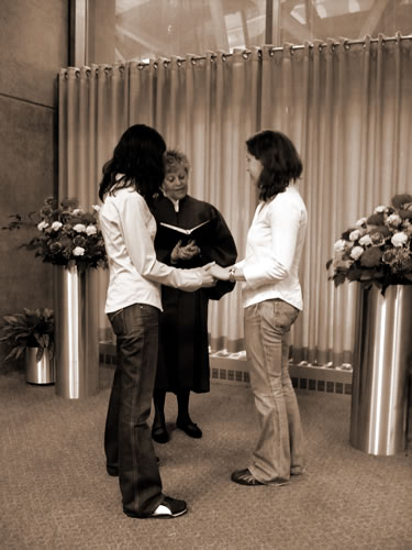 Sepia version of photo of Julie and Amanda at their city hall wedding.