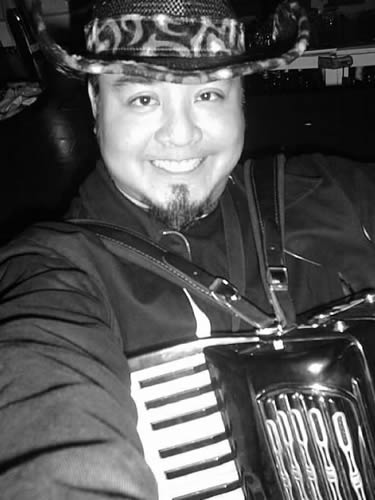 Joey deVilla with accordion, triumphant after the go-go dancing gig.
