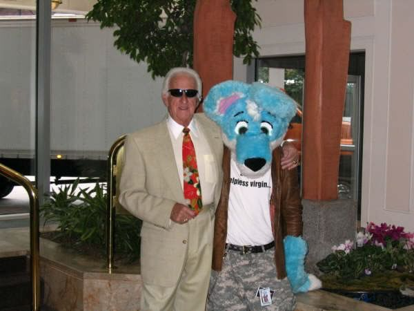 Bob Uecker poses arm in arm with a furry