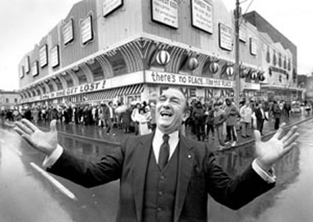 """Honest"" Ed Mirvish poses in front of Honest Ed's"