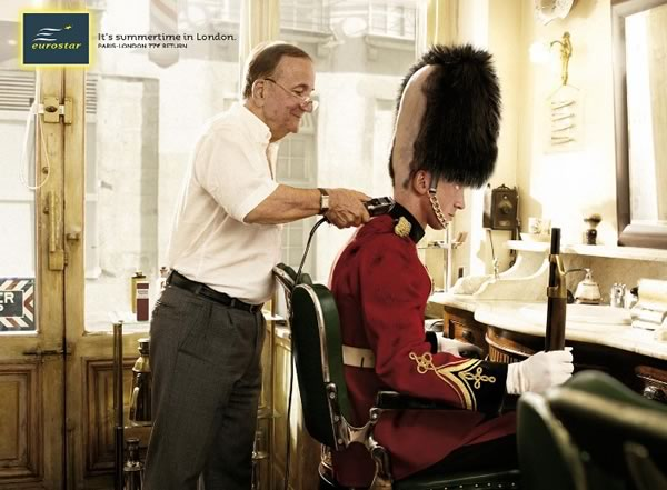 """Eurostar ad """"Summertime in London"""" featuring a London Tower guard getting his head shaved."""