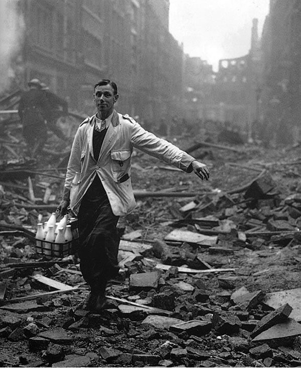 Milkman delivering milk through the rubble of bombed-out London, WWII.