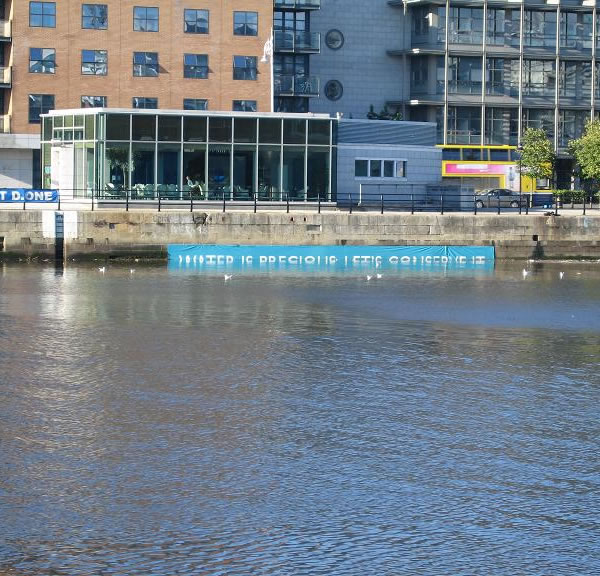 """Water is precious let's conserve it"" banner in Dublin — half submerged"