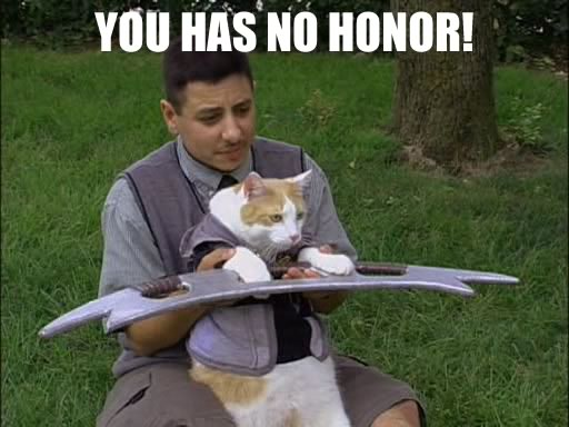 Man assisting cat with bat'leth