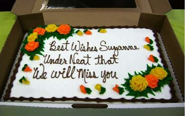 "Cake with writing: ""Best Wishes Suzanne / Under Neat that / We Will Miss You"""
