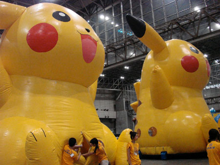 Giant inflatable Pikachu with a doorway in its crotch