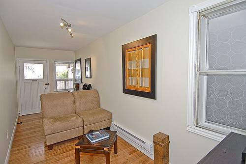 Living room of Toronto's smallest house, looking towards the front.