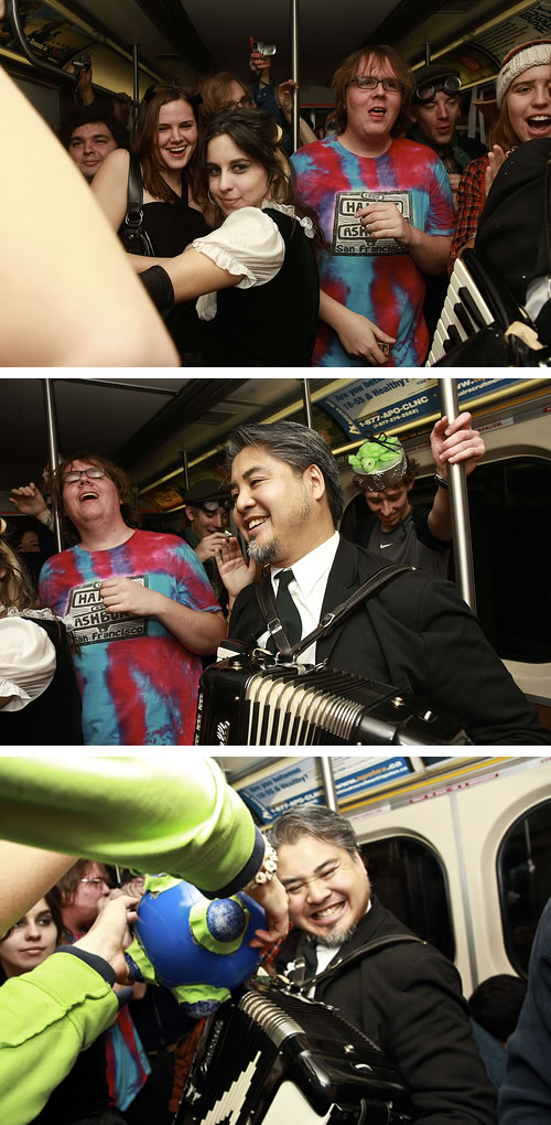 Three shots of me playing accordion at newmindspace's Hallowe'en subway party