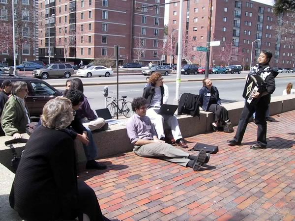Me playing accordion for BloggerCon attendees taking a break on Mass Ave.