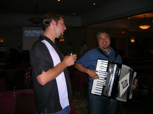 Accordion Guy playing at php|works