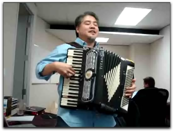 Joey deVilla playing accordion at the TSOT offices