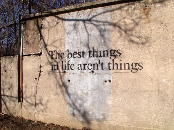 "Photo of stencil graffiti on a wall: ""The best things in life aren't things"""