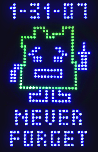 """Lite Brite"" mooninite with the words ""Never forget: 1-31-07″"