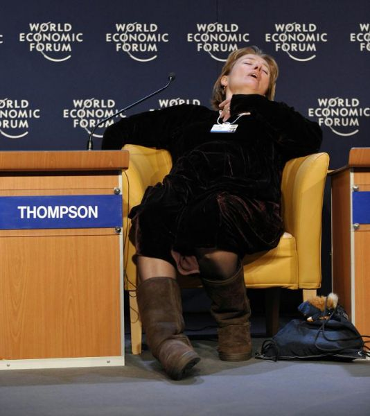 Emma Thompson, slumped and asleep in a chair at the World Economic Forum in Davos.
