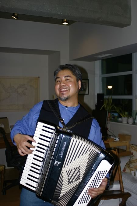 Joey deVilla playing accordion at Tom Purves' and Michelle Perras' housewarming