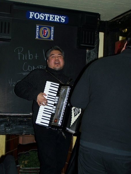 Joey deVilla playing accordion at Hector Catre's birthday at the Rose and Crown, Yonge and Eglinton, Toronto.