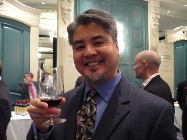 Joey deVilla with a glass of red wine at the Vintages tasting of 2005 Bordeaux wines