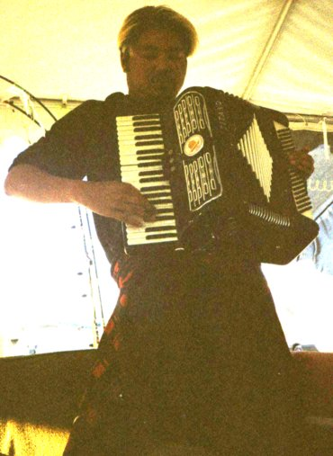 Joey deVilla playing accordion at Burning Man