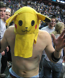 Shirtless man wearing the head from a Pikachu costume