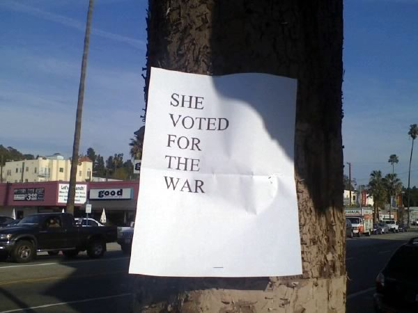 """Plain white laser-printed paper stapled to a tree: """"SHE VOTED FOR THE WAR"""""""