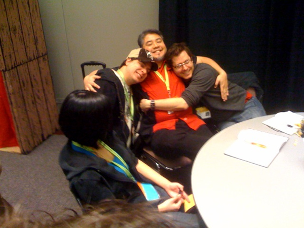 Jeremy Wright, Joey deVilla and David Crow in a group hug