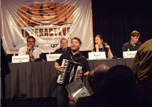 """Joey deVilla plays at the """"How to Rawk SXSW"""" panel at South by Southwest"""
