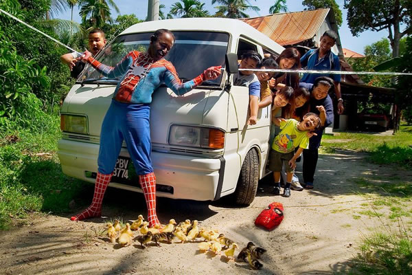 """Guy in a tropical country re-enacting the """"stop the subway train"""" scene from """"Spider-Man 2″."""