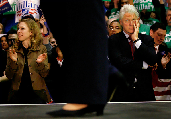 Bill Clinton looking up at Hillary with a resigned expression.