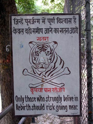 "Warning sign for tiger: ""Only those who strongly believe in rebirth should risk going near."""