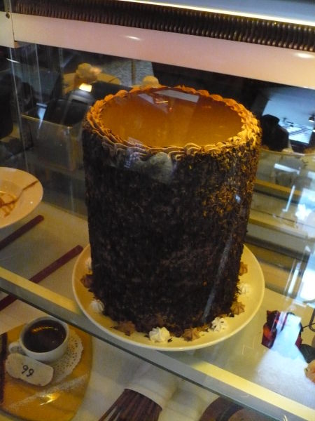 A whole colossal cake sitting in the dessert fridge at Wayne Gretzky's