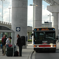 ""\""""Airport Rocket"""" bus pulling into the airport bus stop""250|250|?|en|2|daa23a8925b0e6f389580fdb68957689|False|UNLIKELY|0.30783963203430176