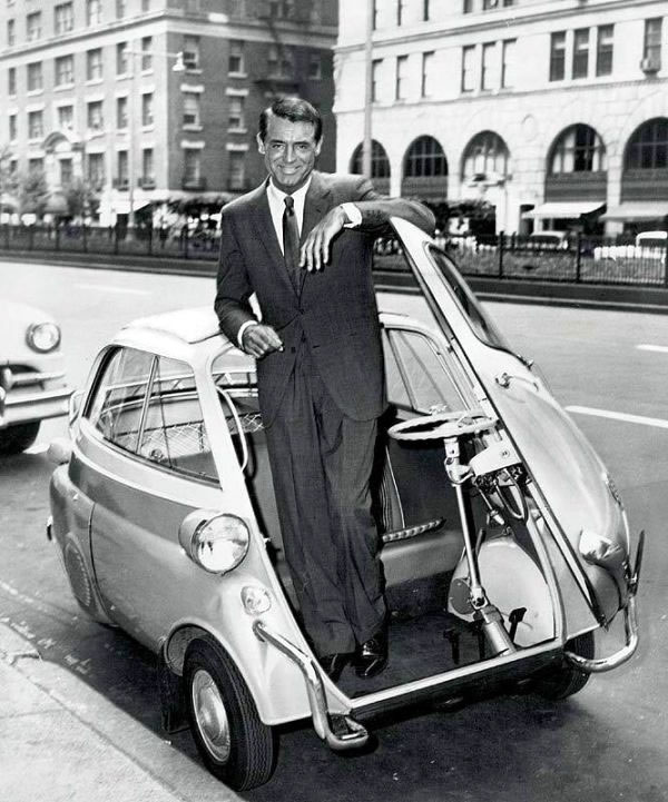Cary Grant exiting a tiny three-wheeled car