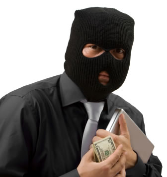 Scam artist wearing a black hood carrying a wad of bills.