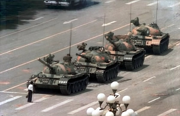 """Tank Man\"" faces down 4 Chinese tanks during the Tienanmen Square Massacre"