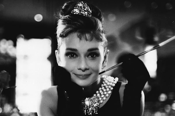 "Audrey Hepburn with a cigerette holder in ""Breakfast at Tiffany\'s\"""