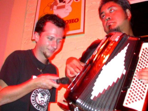 Dorian Logan assists Joey deVilla at Kickass Karaoke, sometime in 2003