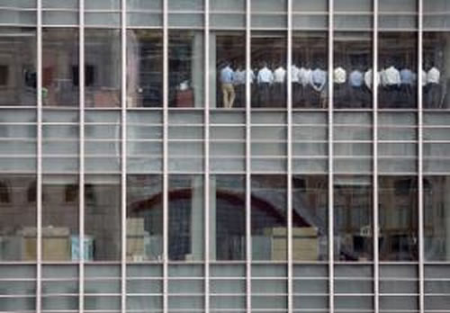 A lineup of stuffed shirts as seen through the windows of Lehman Brothers' London Office.