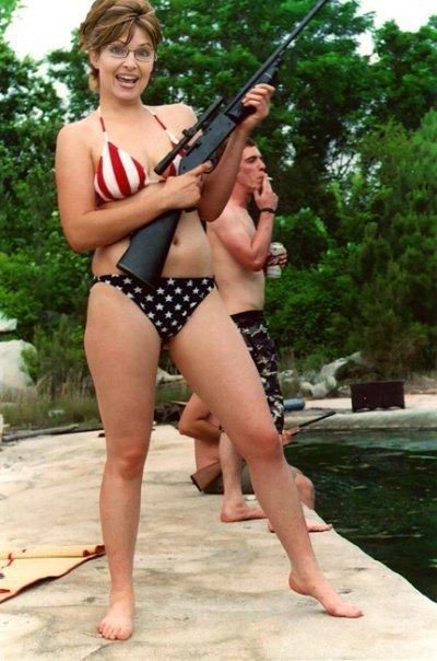 Sarah Palin in a bikini, toting a rifle