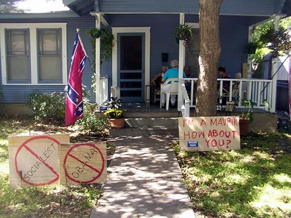 House with Confederate flag and badly spelled signs