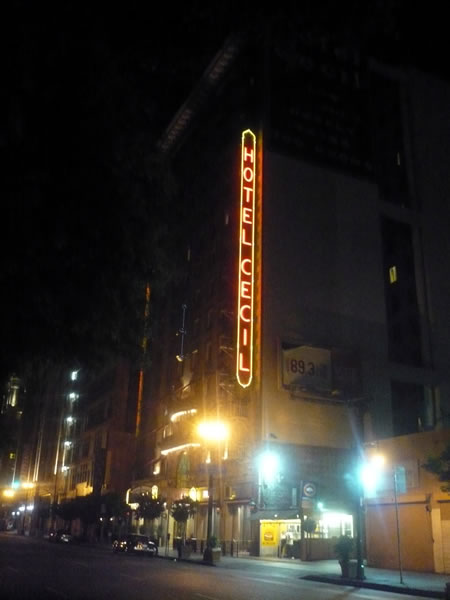 4. Exterior shot of the Hotel Ceicl at night, showing its neon sign aglow