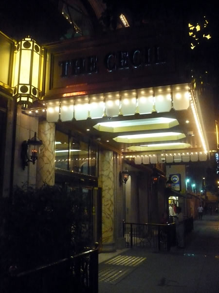 5. Exterior of Hotel Cecil at night, showing the marquee
