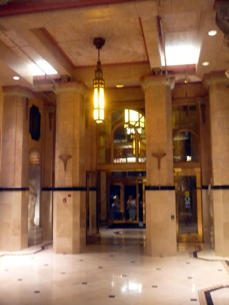 7. Hotel Cecil's marble lobby, looking out